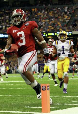 NEW ORLEANS, LA - JANUARY 09:  Trent Richardson #3 of the Alabama Crimson Tide celebrates after scoring a touchdown in the fourth quarter against the Louisiana State University Tigers during the 2012 Allstate BCS National Championship Game at Mercedes-Benz Superdome on January 9, 2012 in New Orleans, Louisiana. Photo: Ronald Martinez, Getty Images / 2012 Getty Images