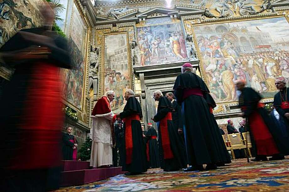 Pope Benedict XVI (L) talks to a cardinal during the traditional exchange of Christmas greetings with the Roman Curia, in the Regia Hall, at the Vatican on December 20, 2010 Photo: Osservatore Romano, AFP/Getty Images