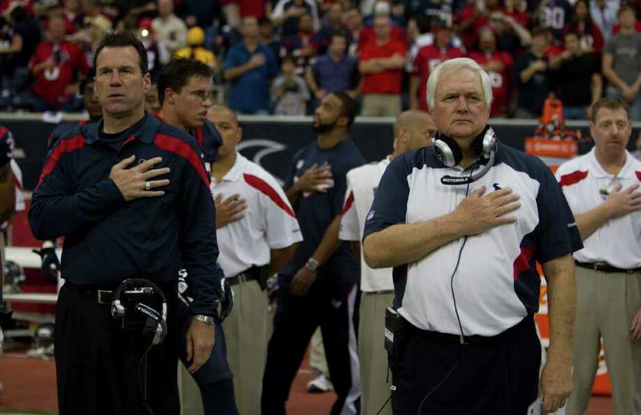 Houston Texans head coach Gary Kubiak, left, and defensive coordinator Wade Phillips stand for the national anthem before an NFL football game against the Atlanta Falcons at Reliant Stadium on Sunday, Dec. 4, 2011, in Houston. ( Brett Coomer / Houston Chronicle ) Photo: Brett Coomer / © 2011  Houston Chronicle