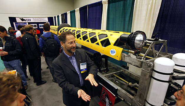 Dr Reed Scherer talks with fellow scientist at the American Geophysical Union annual meeting now taking place at Moscone Center Wednesday Dec 15, 2010. Scientists unveiled a new type of exotic unmanned robotic submarine thatês 28-foot-long rear. The sub will soon take its first dive into Lake Tahoe in March to explore an agent landslide on the west shore that's 50 thousand years old. Photo: Lance Iversen, The Chronicle