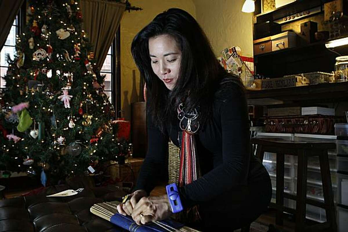 Megumi Inouye wrapping a saw in her living room in San Francisco, Calif., on Monday, December 13, 2010.