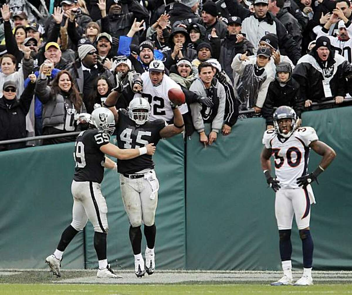 Marcel Reece, center, celebrates his 73-yard touchdown run in the fourth quarter as the Raiders' fans enjoy the moment. The Oakland Raiders played the Denver Broncos at the Oakland-Alameda County Coliseum in Oakland, Calif., on Sunday, December 19, 2010, defeating the Broncos 39-23.