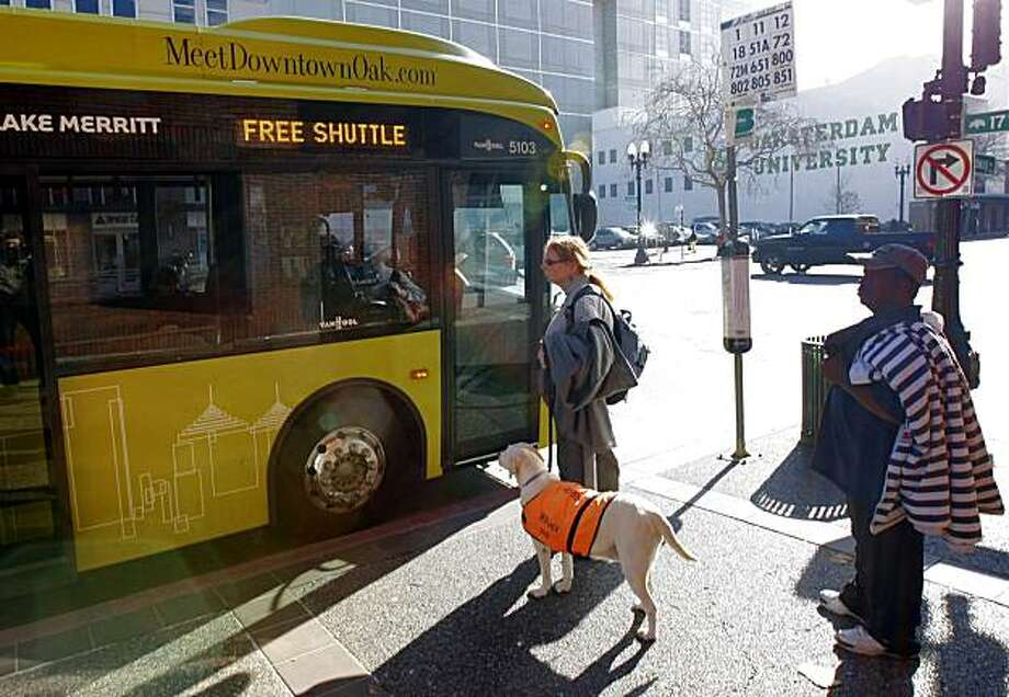 Passengers wait to board  the new free Broadway Shuttle, Thursday, December 16, 2010, oakland, Calif. Photo: Adm Golub, The Chronicle