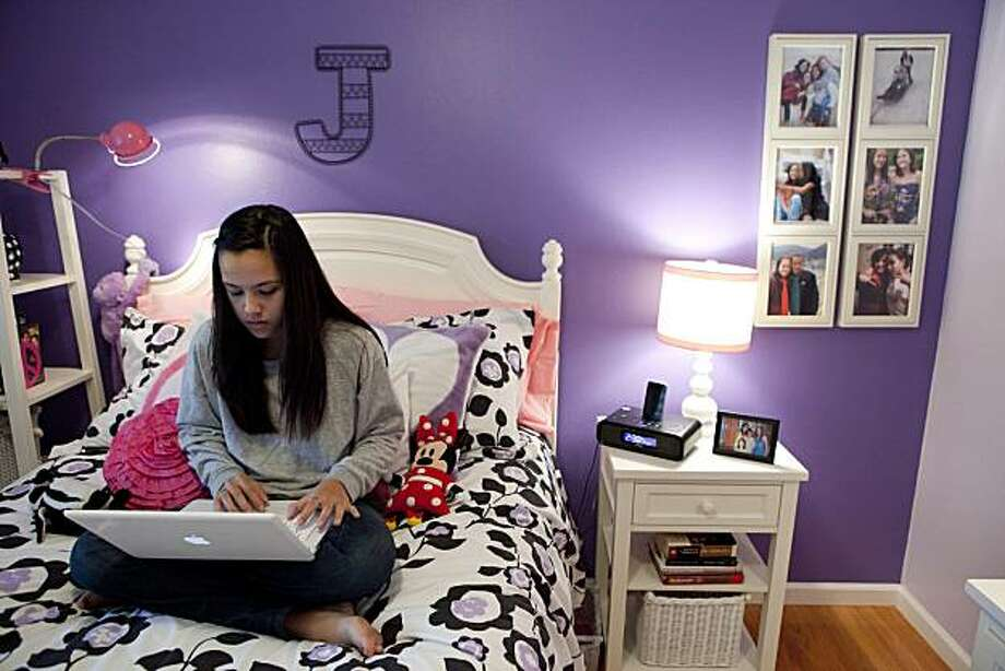 Jordan Barett, 13, works on her laptop in the newly remodeled bedroom she shared with her twin sister, Jensen, before she passed away in August of cancer on Sunday, December 12, 2010 in Saratoga, Calif.  The remodeling of their bedroom was one of 20 things Jensen wanted before she passed away. Photo: John Sebastian Russo, Special To The Chronicle