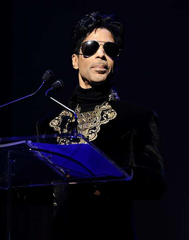 "FILE - In this Oct. 14, 2010 photo, Prince holds a press conference at The Apollo Theater announcing his ""Welcome 2 America"" tour in New York. Photo: Peter Kramer, AP"