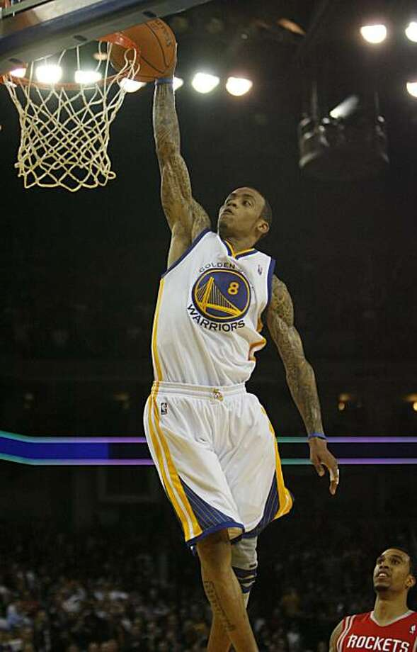 Golden Gate Warriors Monta Ellis, (8), scores against the Houston Rockets in the fourth quarter on Monday, Dec. 20, 2010 at the Oracle Arena in Oakland, Calif.  The Golden Gate Warriors lose the Houston Rockets 112 to 121. Photo: Kirsten Aguilar, The Chronicle