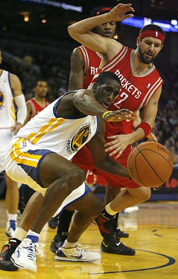 Golden Gate Warriors Ekpe Udoh, (20), tries to gain control of the ball after knocking it lose from Houston Rockets Brad Miller's hand, (52), in the first quarter, Monday, Dec. 20, 2010 at the Oracle Arena in Oakland, Calif. Photo: Kirsten Aguilar, The Chronicle