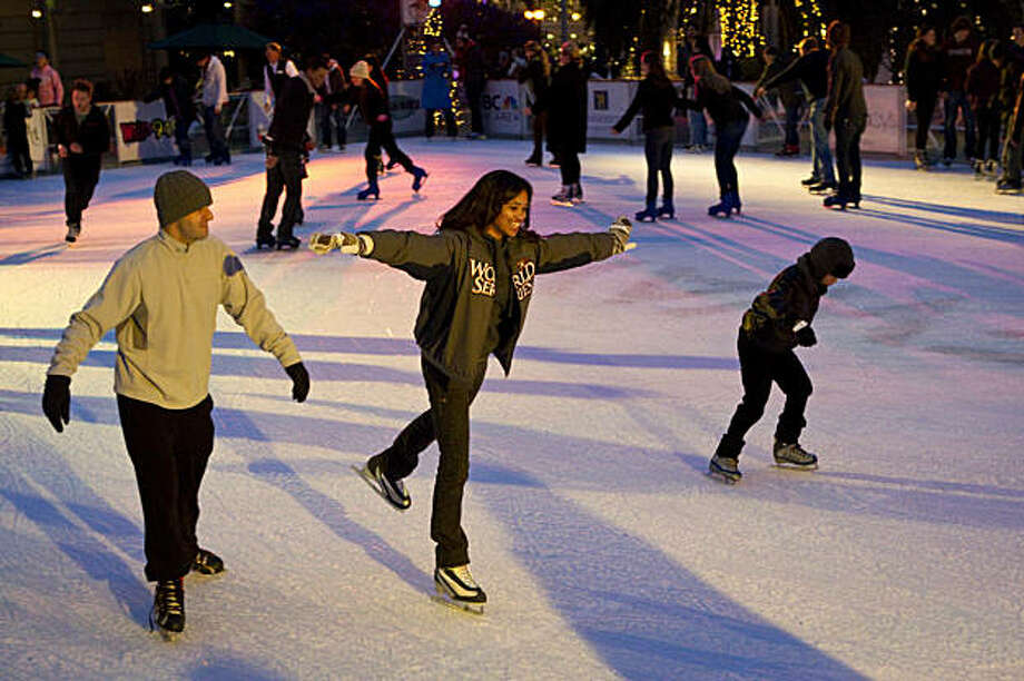 Kayla Hilton (center) works on skating on one foot while enjoying the  Holiday Ice Rink in Union Square in San Francisco, Calif., on Thursday, December 16, 2010.  The rink is scheduled to remain open until January 17, 2011. Photo: Laura Morton, Special To The Chronicle