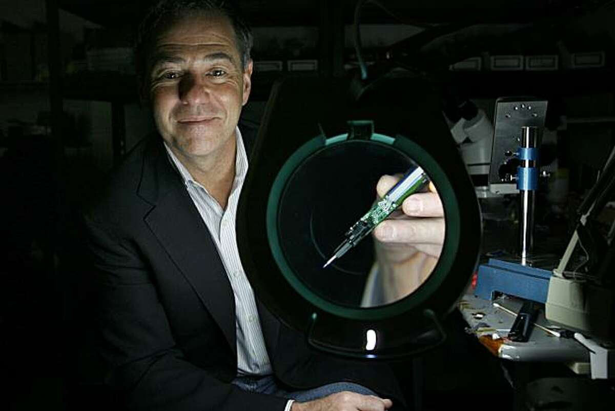 Founder and chief executive of Livescribe, Jim Marggraff, 51, holds the company's newest product, the Echo smartpen, that's been dismantled in a hard drive engineering lab located in Livescribe's offices in Oakland, Calif. on Monday, December 13, 2010. Livescribe claims to have sold 500,000 smart pens in two years, and has secured $100 million in financing.
