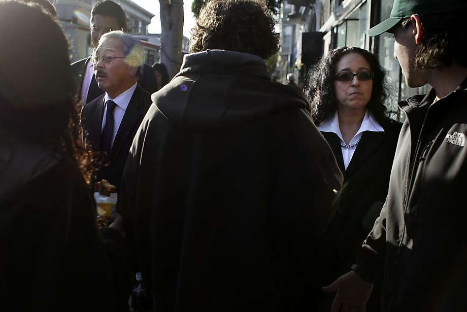 Mayor Ed Lee (l to r) and newly appointed District 5 Supervisor Christina Olague (right) talk to business owners and residents during a merchant walk on Monday, January 9, 2012 in San Francisco, Calif. Photo: Lea Suzuki, The Chronicle