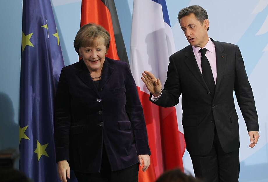 BERLIN, GERMANY - JANUARY 09:  German Chancellor Angela Merkel and French President Nicolas Sarkozy depart after speaking to the media following talks at the Chancellery on January 9, 2012 in Berlin, Germany. The two leaders discussed the ongoing Eurozone debt crisis as well as a possible European financial transaction tax, among other topics.  (Photo by Sean Gallup/Getty Images) Photo: Sean Gallup, Getty Images