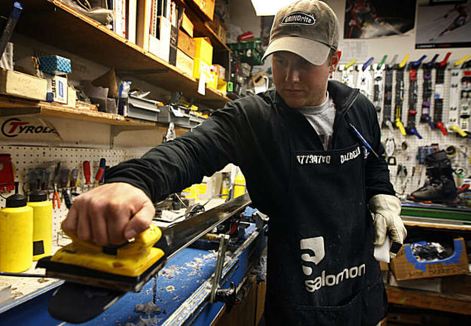 Bobby Panighetti adds a fresh layer of wax to a pair of skis at California Ski Company in Berkeley, Calif., on Thursday, Dec. 16, 2010. A recent study shows that perflourochemicals in ski wax carry potentially serious health risks. Photo: Paul Chinn, The Chronicle