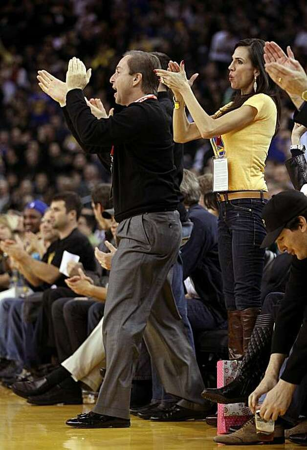 OAKLAND, CA - DECEMBER 14:  Golden State Warrior co-owner Joe Lacob and Nicole Curran cheer for the Warriors during their game against the Minnesota Timberwolves at Oracle Arena on December 14, 2010 in Oakland, California.  NOTE TO USER: User expressly acknowledges and agrees that, by downloading and or using this photograph, User is consenting to the terms and conditions of the Getty Images License Agreement. Photo: Ezra Shaw, Getty Images