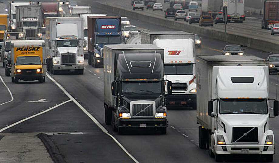 Trucks make their way on eastbound I-580 Friday, Dec. 17, 2010, in Livermore, Calif. Businesses will have more time to comply with California's tough diesel emissions standards for trucks, buses and construction equipment under new, relaxed rules expectedto be adopted by air quality officials. Photo: Ben Margot, AP