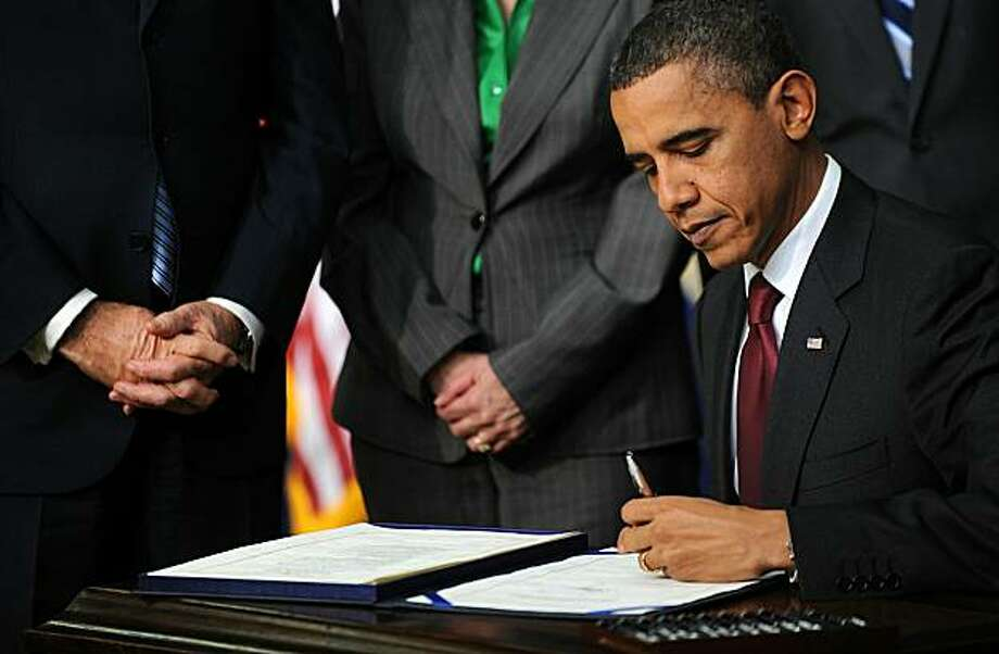 WASHINGTON, DC - DECEMBER 17:  (AFP OUT) US President Barack Obama signs the middle-class tax cut bill in the South Court Auditorium December 17, 2010 in Washington, DC. The measure would extend tax cuts for families at every income level, renew jobless benefits for the long-term unemployed and enact a new one-year cut in Social Security taxes that would benefit nearly every worker who earns a wage. Photo: Pool, Getty Images
