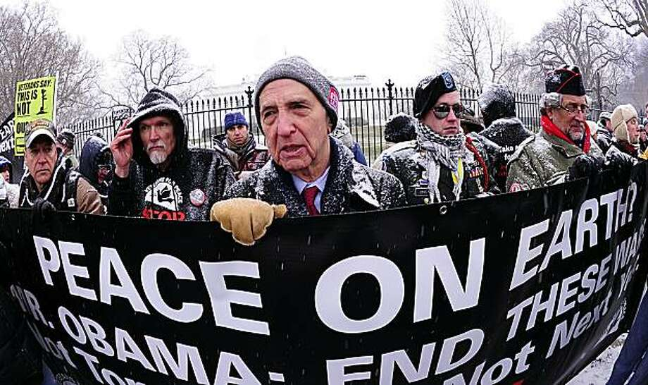 "Daniel Ellsberg(C), former military analyst who released the ""Pentagon Papers"" in 1971, speaks to the media during an anti-war protest December 16, 2010 in front of the White House in Washington, DC . Ellsberg and several others were arrested for civil disobedience. Photo: Karen Bleier, AFP/Getty Images"