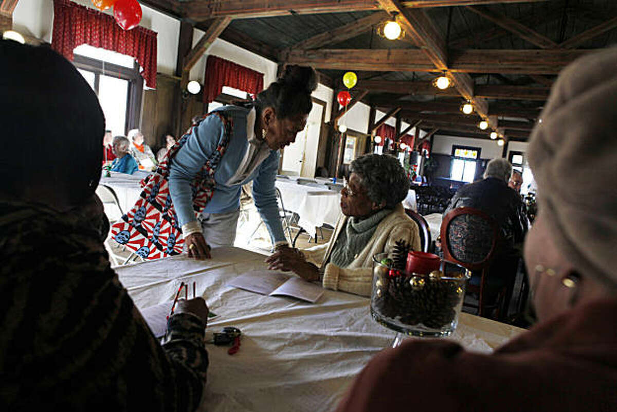 Residents Marsha Thomas-Cooke (l to r) and Ida Cotton greet each other before the grand opening celebration in the Community Room at The Altenheim on Thursday, December 16, 2010 in Oakland, Calif. The Altenheim, is a former senior assisted living facility on a six-acre campus in the City of Oakland's Diamond/Glenview district. The newly restored campus consists of 174 new apartments for for senior households earning 20% to 50% of Area Median income.