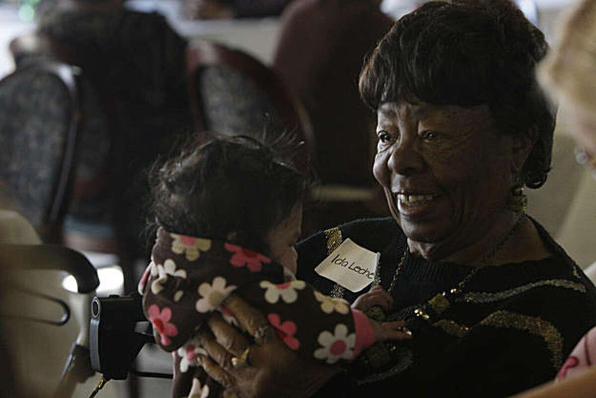 Resident Ida Leche (right) visits with Mercedes Arevalo (left), 6 months, during the grand opening celebration at The Altenheim on Thursday, December 16, 2010 in Oakland, Calif. Mercedes' mother, Sandra Arevalo, used to be an in home care provider for Leche while she was pregnant with Mercedes. The Altenheim, is a former senior assisted living facility on a six-acre campus in the City of Oakland's Diamond/Glenview district. The newly restored campus consists of 174 new apartments for for senior households earning 20% to 50% of Area Median income.