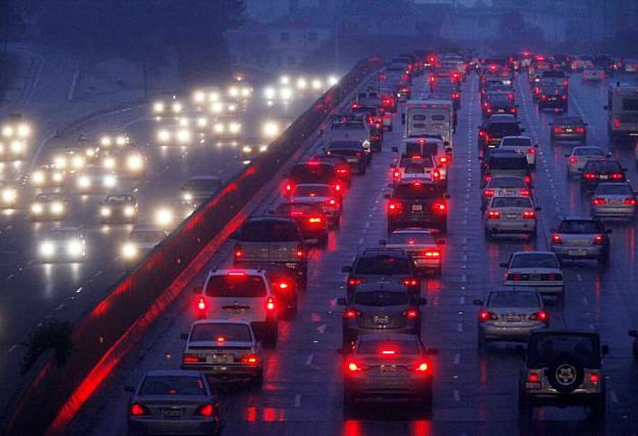 Evening commuters brave wet roads and heavy traffic on eastbound I-580 at the Grand Avenue exit on Friday in Oakland. Photo: Mike Kepka, The Chronicle