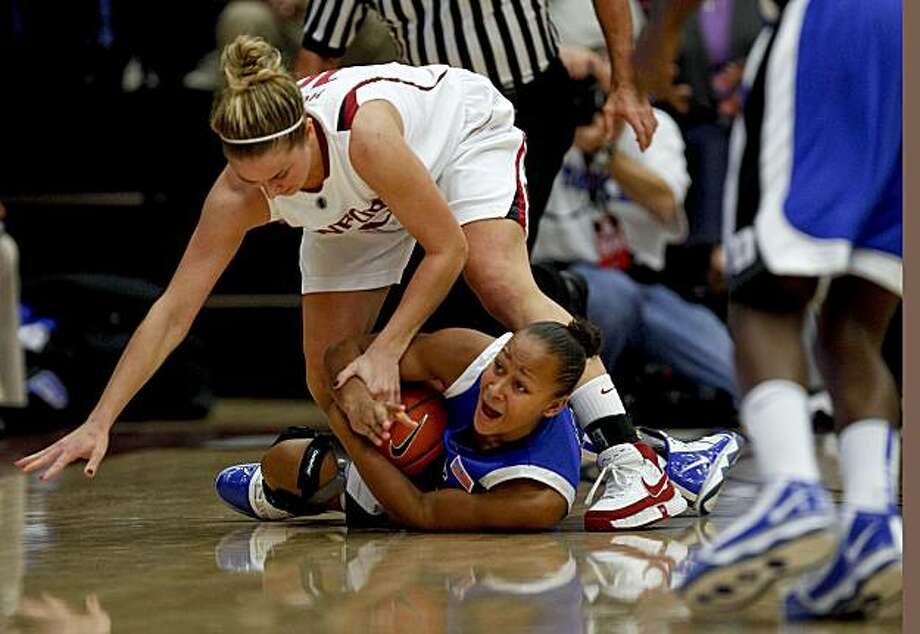 Stanford's JJ Hones (10) and Duke's Shay Selby (3) battle for a loose ball in the 2nd half as the Stanford Cardinal women beat the Duke Blue Devils 71-55 in Palo Alto, Ca. on Tuesday December 15, 2009. Photo: Michael Macor, The Chronicle
