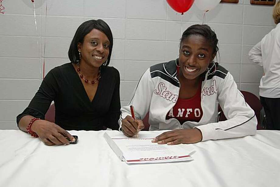 Chiney Ogwumike, right, with her mother, Ify Ogwumike, as she signs her letter of intent to Stanford Photo: Courtesy Cy-Fair High School