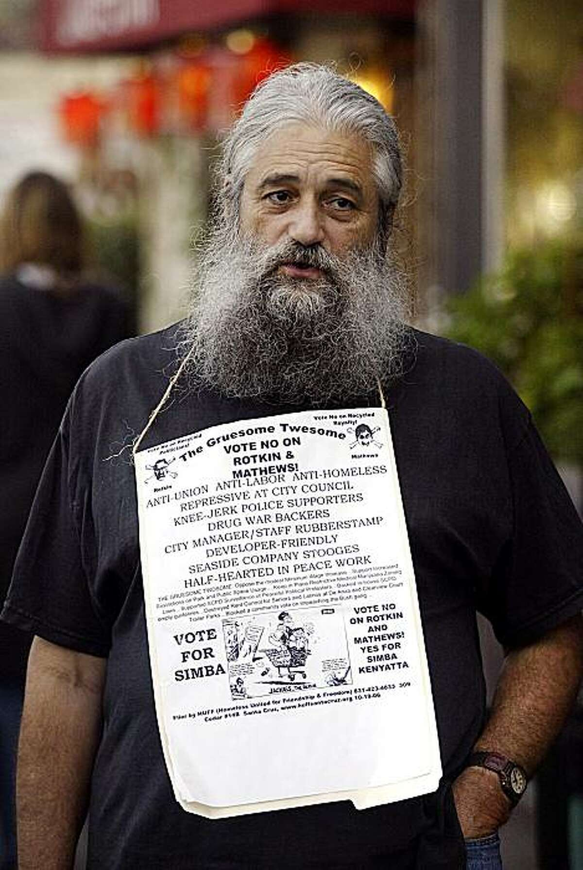 FILE - In this Nov. 6, 2009 file photo, homeless advocate Robert Norse is seen in Santa Cruz, Calif. A federal appeals court has ordered a trial judge to reconsider a lawsuit by Norse who was arrested for raising a Nazi salute during a city council meeting. Norse claims his free speech rights were violated with the 2002 arrest.