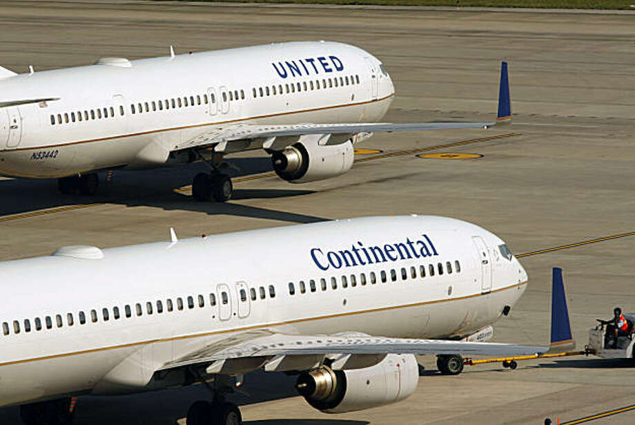 A newly painted United Airlines plane, with Continental's blue and gold colors and globe logo on the tail, top, leaves Bush Intercontinental Airport in Houston Friday, Oct. 1, 2010. Photo: Michael Stravato, AP
