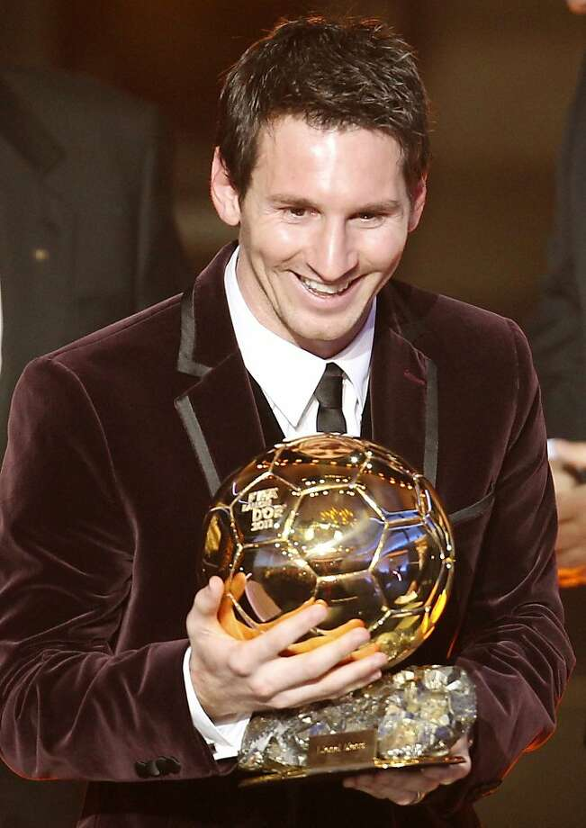Argentina's Lionel Messi is awarded the prize for the soccer player of the year 2011 at the FIFA Ballon d'Or awarding ceremony in Zurich, Switzerland, Monday, Jan. 9, 2012. (AP Photo/Michael Probst) Photo: Michael Probst, Associated Press