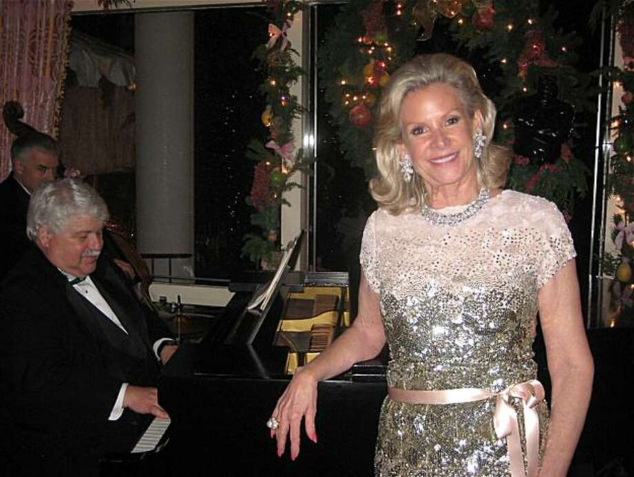 Dede Wilsey (with pianist Chris Piazza) hosted her annual Christmas Party in her home last week. December 2010. By Catherine Bigelow. Photo: Catherine Bigelow, Special To The Chronicle