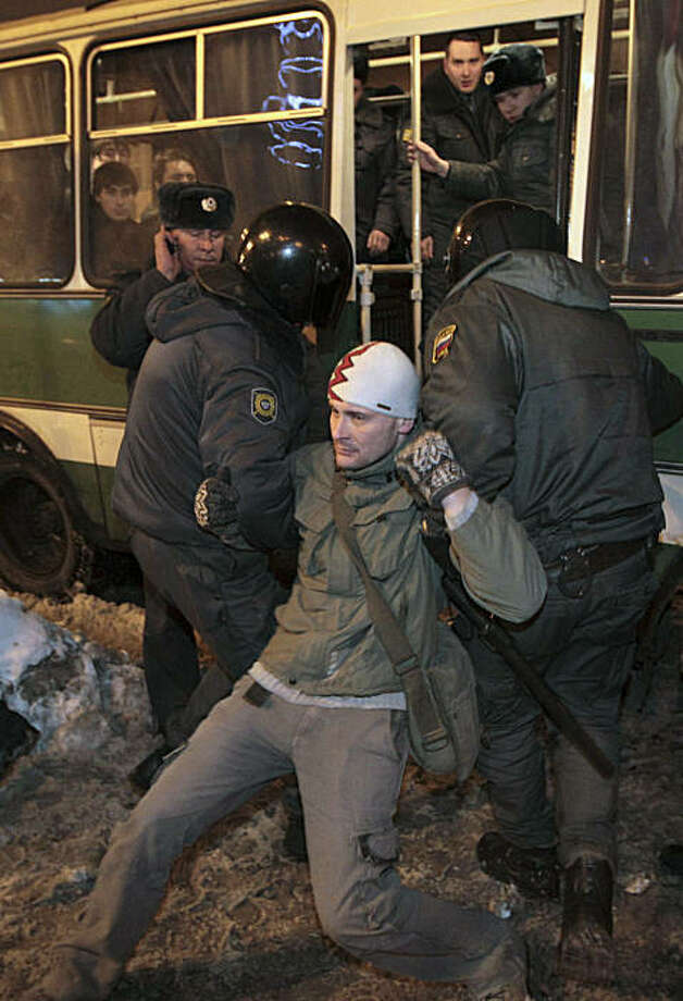 Riot police officers detain protester outside Sennaya Ploshchad metro station in St. Petersburg, Russia, on Wednesday, Dec. 15, 2010. Dozens of riot police deployed around central St. Petersburg Wednesday to prevent possible ethnic clashes after the weekend rioting by racist hooligans fueled rumors that minorities could try to retaliate. Photo: AP