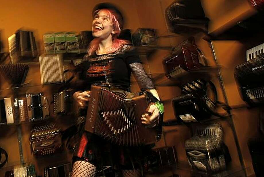 Catching up with San Francisco street performer, Renee de la Prade, on Thursday Dec. 2 , 2010, in Oakland, Calif., who has created the Accordian Babes Pin-up calendar. Photo: Michael Macor, The Chronicle