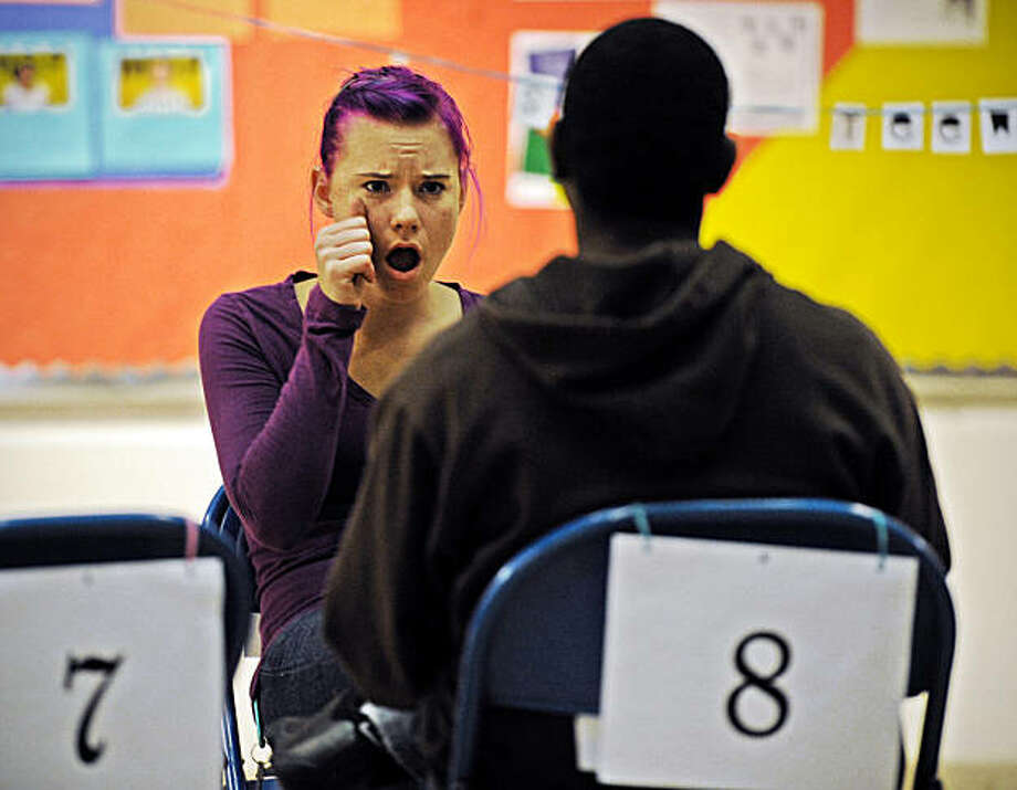 A couple gets acquainted at a speed-dating night at Gallaudet University, a school for the deaf in Washington. Illustrates DEAFDATE (category l), by Jenna Johnson (c) 2010, The Washington Post. Moved Monday, Dec. 13, 2010. (MUST CREDIT: Washington Post photo by Bill O'Leary.) Photo: O'leary, The Washington Post