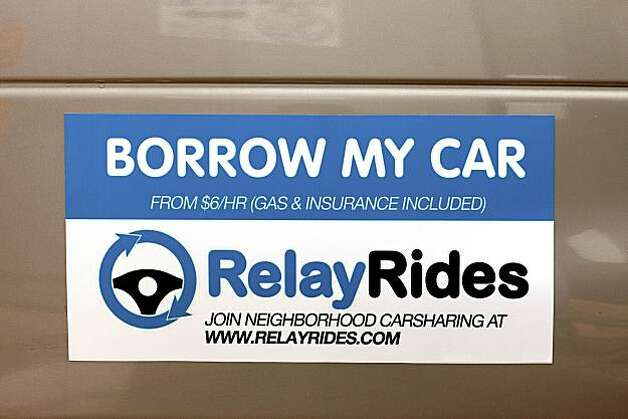A RelayRides magnetic sign is displayed on a car outside of the company's office in San Francisco, California, U.S., on Thursday, Dec. 9, 2010. RelayRides, the world's first neighbor-to-neighbor car-sharing service, will launch in San Francisco on December 14, backed by a $4.5 million Series A investment from August Capital and Google Ventures. Photographer: David Paul Morris/Bloomberg   HOLD FOR SF CHRON STORY BY ARI LEVY - EMBARGOED UNTIL MIDNIGHT TUESDAY, DEC. 14, 2010 (00:00 NY TIME) Photo: David Paul Morris, Bloomberg