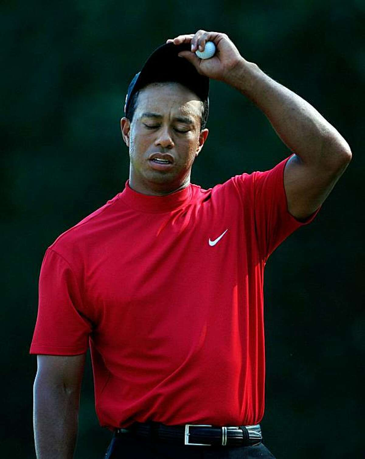 PONTE VEDRA BEACH, FL - MAY 10: Tiger Woods reacts on green of the 12th hole during the final round of THE PLAYERS Championship on THE PLAYERS Stadium Course at TPC Sawgrass on May 10, 2009 in Ponte Vedra Beach, Florida. (Photo by Jamie Squire/Getty Images)