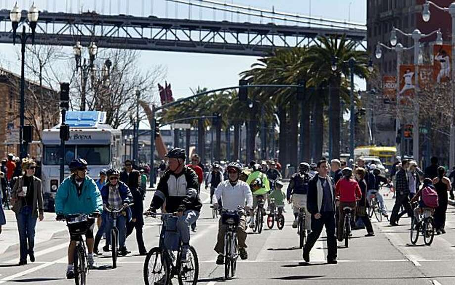 Pedestrians share the road with cyclists and skaters near the Ferry Building during San Francisco's first Sunday Streets event of the year, which shut down the Embarcadero from the AT&T Park to Pier 45. Photo: Brant Ward, The Chronicle