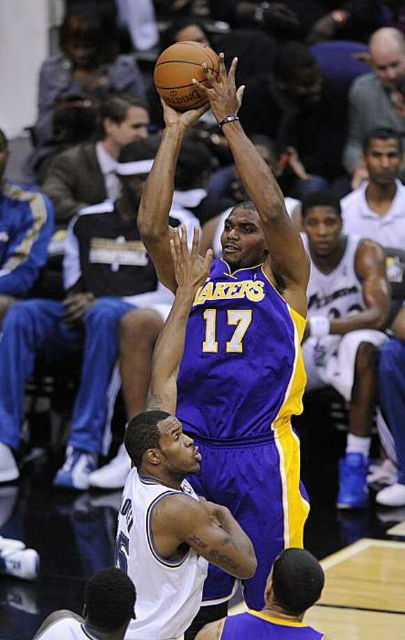 Los Angeles Lakers center Andrew Bynum (17) puts up a shot against Washington Wizards center Trevor Booker, left, during the second half of an NBA basketball game, Tuesday, Dec. 14, 2010, in Washington. The Lakers won 103-89. Photo: Nick Wass, AP