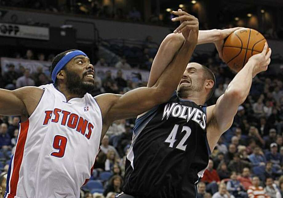 Minnesota Timberwolves forward Kevin Love (42) wrestles a rebound away from Detroit Pistons forward Chris Wilcox (9) during the second quarter of an NBA basketball game in Minneapolis, Friday, Dec. 10, 2010. Photo: Ann Heisenfelt, AP