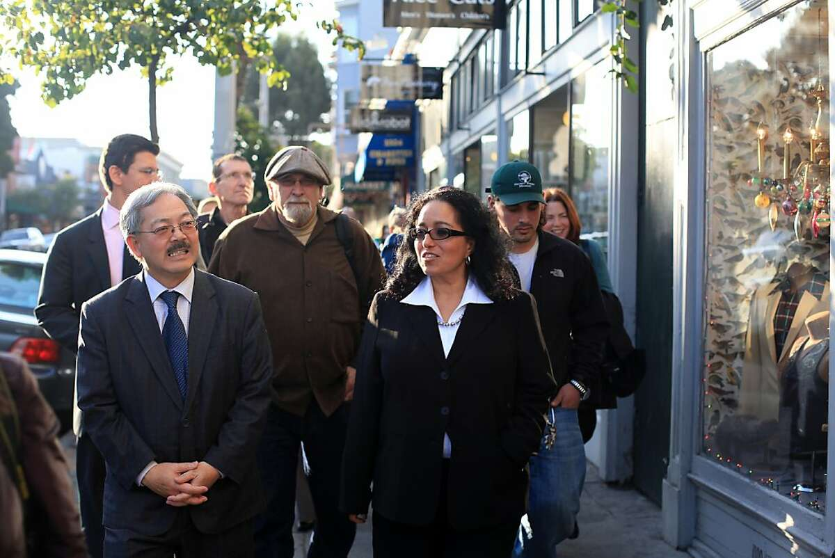 Mayor Ed Lee (left) and newly appointed District 5 Supervisor Christina Olague walk on Haight Street during a merchant walk last January.