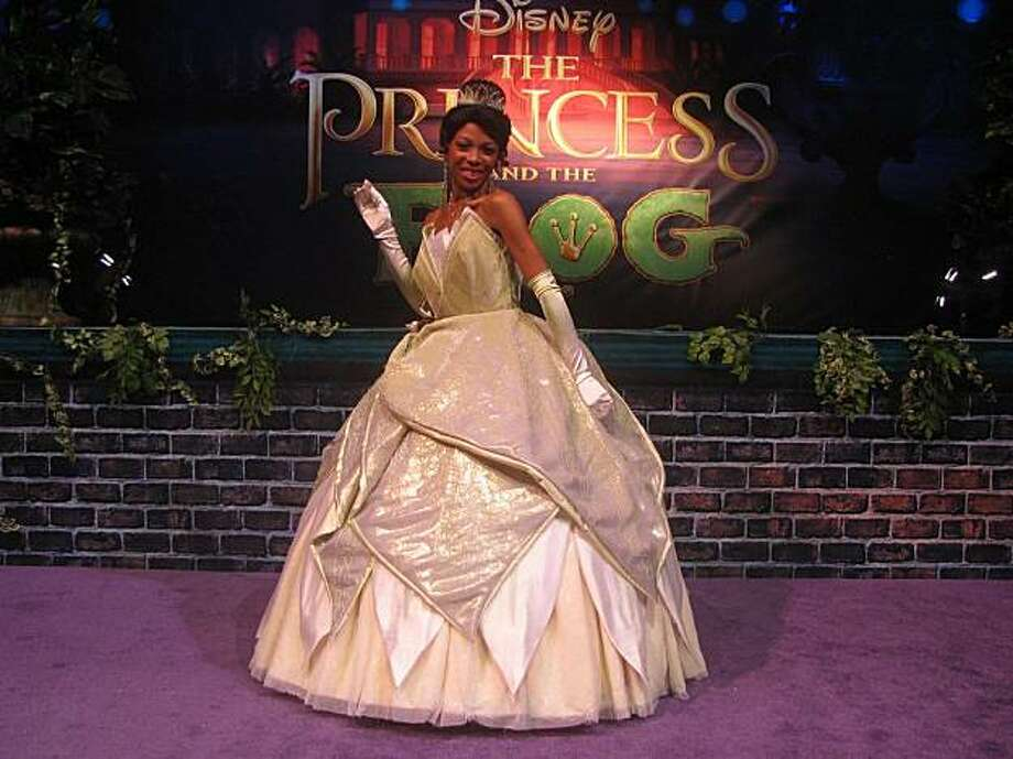 "At the Disney Ultimate Experience, a recent promotional event in New York for the new animated film, ""The Princess and the Frog,"" an actress plays Princess Tiana, the film's lead character. Photo: Jeff Yang"