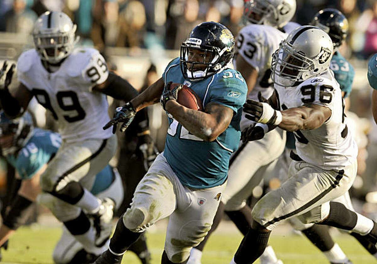 Jacksonville Jaguars running back Maurice Jones-Drew (32) scores on a 30-yard run against the Oakland Raiders during the fourth quarter of an NFL football game, Sunday, Dec. 12, 2010, in Jacksonville, Fla. Jaguars beat the Raiders 38-30.