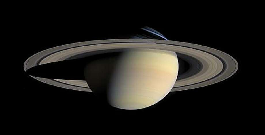 This image provided by NASA, taken Oct. 6, 2004, by the Cassini Saturn Probe, shows the planet Saturn and its rings. One of the most evocative mysteries of the solar system, where Saturn got its stunning rings, may actually be a case of cosmic murder withan unnamed moon of Saturn, that disappeared about 4.5 billion years ago, as the potential victim. Suspicion has fallen on a disk of hydrogen gas, that surrounded Saturn when its dozens of moons were forming, but has now fled the scene. And the cause of death? A possible forced plunge into Saturn. Photo: AP