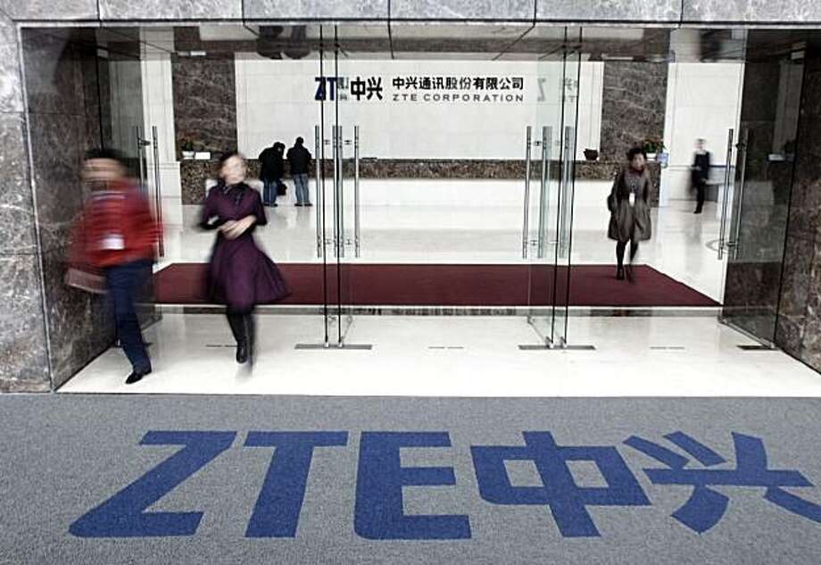 Employees and visitors walk out of the ZTE Corp. headquarters in Shenzhen, Guangdong province, China, on Tuesday, Nov. 17, 2009. ZTE Corp. manufactures and markets networking and telecommunications equipment. Photographer: Photo: Qilai Shen, Bloomberg