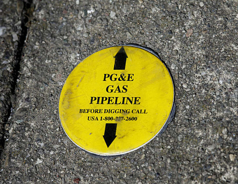 On Glenview Drive just a few houses from the broken gas line, a warning sticker on the sidewalk is still evident. First responders to the San Bruno, Calif. pipeline explosion talked about their experiences Tuesday September 14, 2010. Photo: Brant Ward, The Chronicle