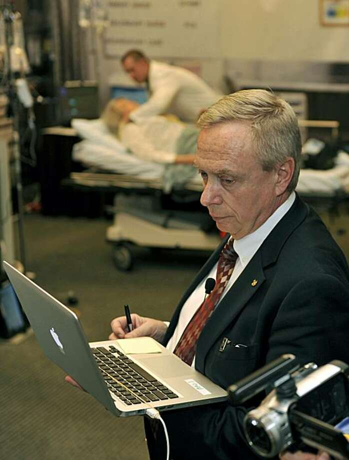 In this March 14, 2010 file photo, William Hamman watches data on a computer as he supervises doctors during a cardiology simulation at the Georgia World Congress Center in Atlanta. Hamman, an airline captain who lives in Michigan, claimed to be a cardiologist and trained other doctors in teamwork. But he never got a medical degree. Photo: Gregory Smith, AP