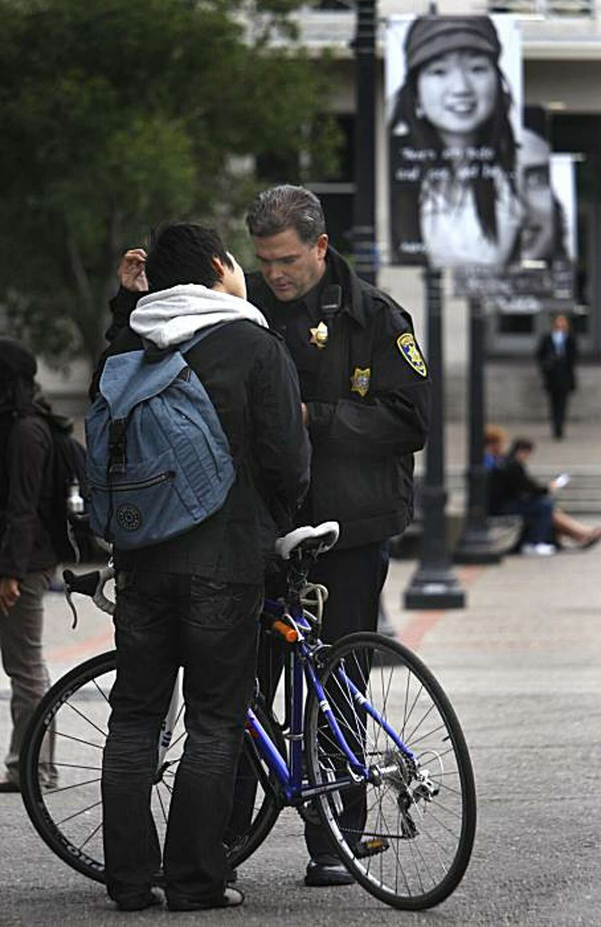 UC police officer Lawrence Green issues a verbal warning to a student who was caught riding his bicycle through the designated dismount zone near Wheeler Hall at UC Berkeley on Thursday, Dec. 2, 2010. Officer Green said bicycle riders create an