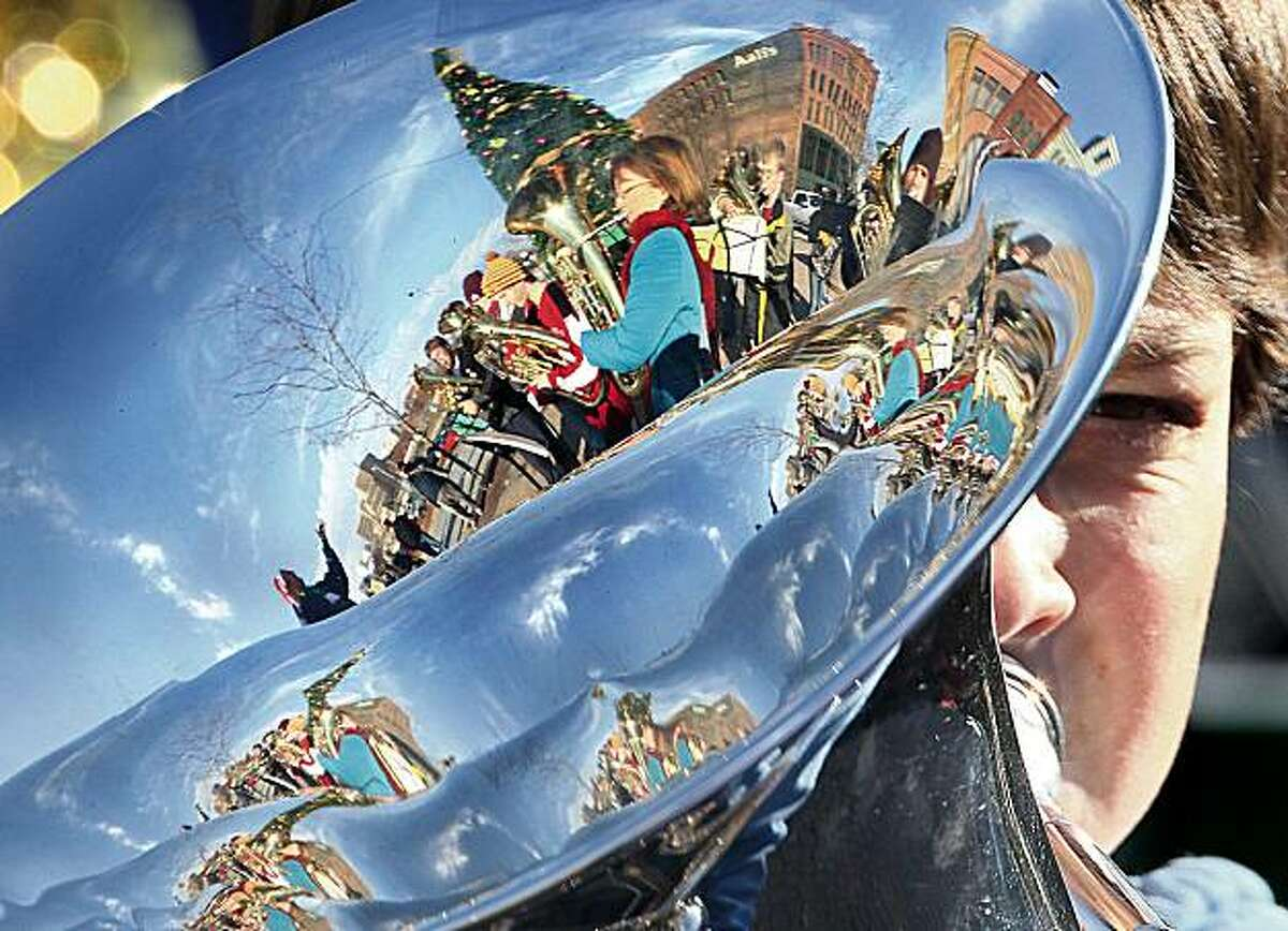 Jacob Kuhn 12, Sioux City, plays tuba during Tuba Christmas at the Fountain on the Promenade in Sioux City, Iowa, Saturday, Dec. 5, 2009.