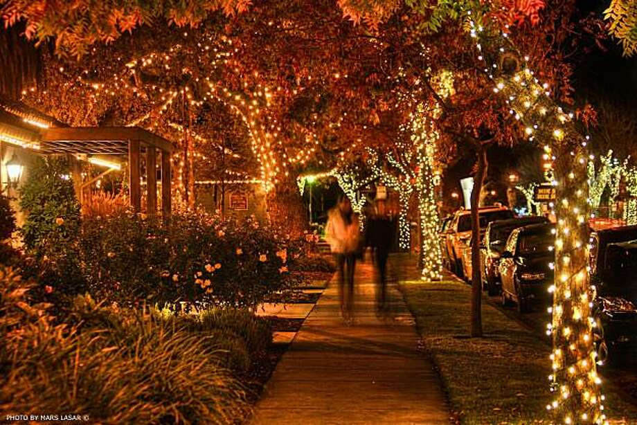 Yountville is illuminated for enjoying evening activities, such as ice skating and window shopping, for the holidays. Photo: Mars Lasar