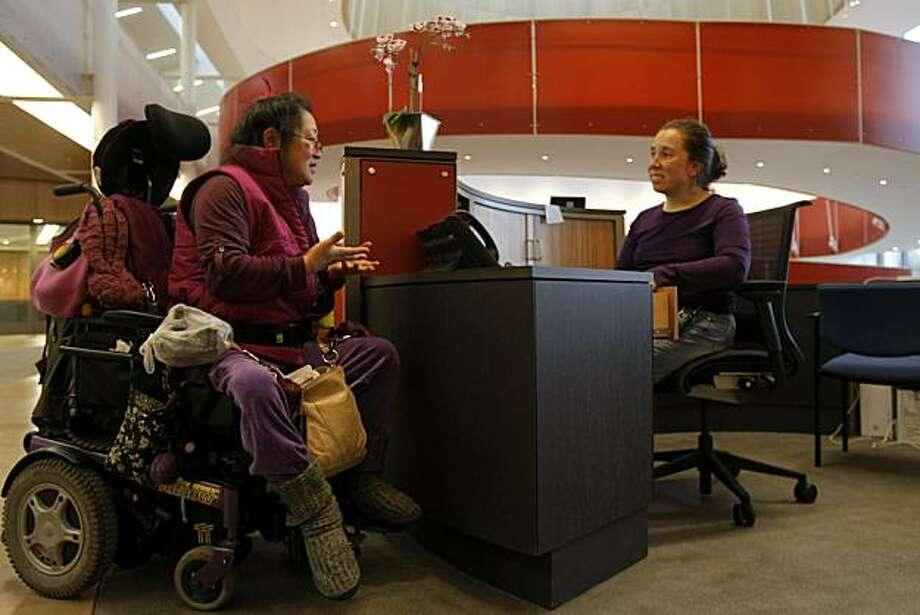Stephanie Miyashiro (left), chair member of Through the Looking Glass nonprofit organization, introduces herself to receptionist Leah Frenchick in Berkeley, Calif., on Dec. 10, 2010.   The Ed Roberts Campus, named after Edward V. Roberts, a leader of the independent living movement, showcases design accessible to all in Berkeley, Calif., on Dec. 10, 2010. Photo: Michelle Gachet, The Chronicle