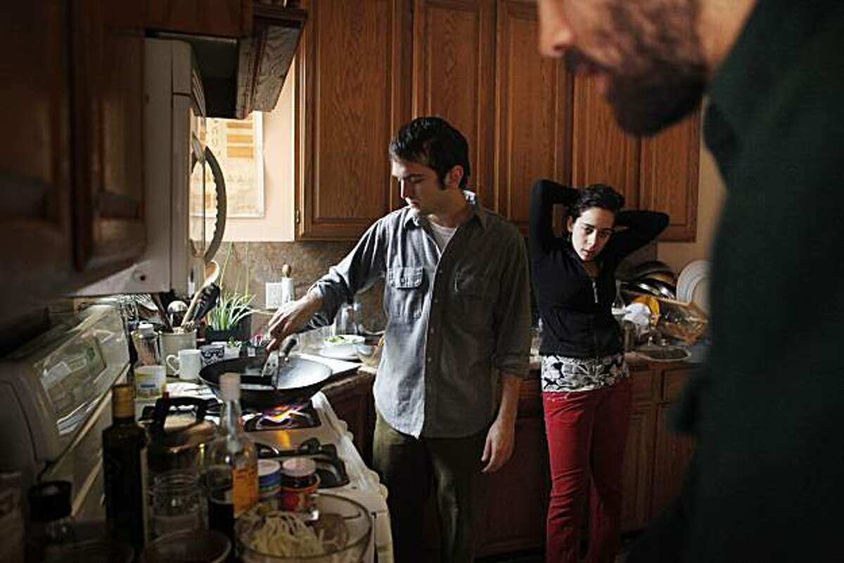 """Ian Sherman, Deb Meisel, and David Gumbiner, members of """"The Udon Project"""" participating in Yoxi's fast food competition, to reinvent fast food, cook a pad Thai-like concept in their kitchen that they hope will take them to the top on Thursday Dec. 9, 2010 in San Francisco, Calif."""