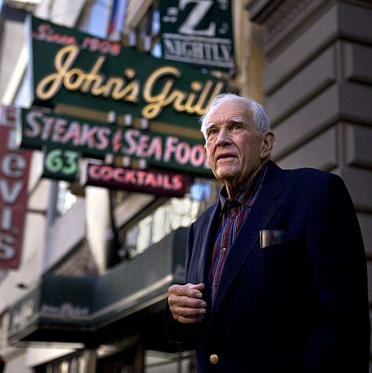 Writer Joe Gores stands outside John's Grill in San Francisco. Gores is a former detective and veteran crime-fiction writer. His newest novel,